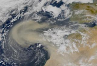 Large amounts of dust move westward from the African coast
