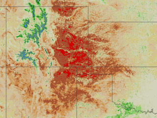 Images created from France's SPOT satellite show the health of vegetation as severely weakened indicating very dry conditions over large areas of the western U.S.