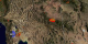 This animation shows a zoom out from the Southwestern US while fires detected between 5-1-2002 and 8-20-2002 are displayed. A clock inset indicates the date.