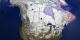 This image shows the snow cover and sea ice surface temperature over North America on February 9, 2003.