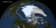An image of the Arctic sea ice on September 13, 2012, the day that NASA scientists identified to be the minimum area in 2012. The yellow outline shows the average sea ice minimum from 1979 through 2010.  The sea ice is shown with a blue tint.