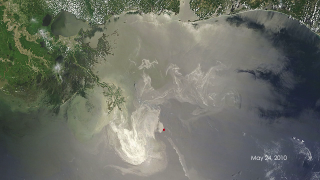 This short video reveals a space-based view of the burning oil rig (from the MODIS instrument on board NASA's Terra and Aqua satellites) and, later, the ensuing oil spill through May 24, 2010. The oil slick appears grayish-beige in the images and changes due to changing weather, ocean currents, and the use of oil dispersing chemicals. Images in the video time series were selected that show the spill most clearly.