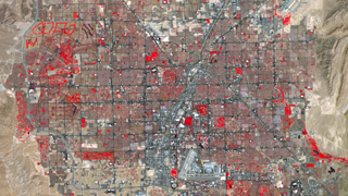 Parks and golf courses (red) comprise the majority of irrigated vegetation seen surrounding the Las Vegas Strip (center).