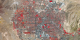 Still image of Las Vegas, 2010, from Landsat data.  This false-color image shows healthy vegetation in red and roads and buildings in gray.  The brightest red colors are mostly golf courses, with a small number of city parks, and one lone wetlands area stretching away from the southwest edge of the city.