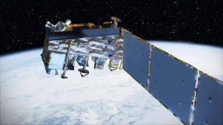 An artist concept of the polar-orbiting NPP spacecraft flying over the North Pole.