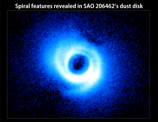 Two spiral arms emerge from the gas-rich disk around SAO 206462, a young star in the constellation Lupus. This image, acquired by the Subaru Telescope and its HiCIAO instrument, is the first to show spiral arms in a circumstellar disk. The disk itself is some 14 billion miles across, or about twice the size of Pluto's orbit in our own solar system. No Labels. Credit: NAOJ/Subaru