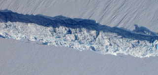 This close-up of the rift opening up across the Pine Island Glacier ice shelf was captured by the nadir-looking Digital Mapping System (DMS) on NASA's DC-8, which flew over the rift of Oct. 26, 2011.  The rift measured about 820 feet across at its widest and about 200 feet at its deepest.