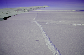 NASA's DC-8 flew over the Pine Island Glacier Ice Shelf on Oct. 14, 2011, as part of Operation IceBridge.  A large, long-running crack was plainly visible across the ice shelf.  The DC-8 took off on Oct. 26, 2011, to collect more data on the ice shelf and the crack.  The area beyond the crack that could calve in the coming months covers about 310 square miles (800 sq. km).