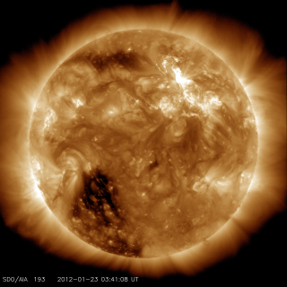 Solar Dynamics Observatory captured the flare, shown here in bronze as that is the color typically used to show light in the 193 Angstrom wavelength. The flare began at 10:38 PM ET on Jan. 22, peaked at 10:59 PM and ended at 11:34 PM. Credit: NASA/SDO/AIA