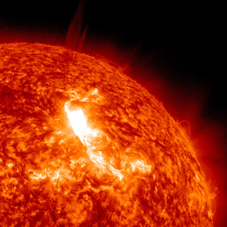 Solar Dynamics Observatory captured the flare, shown here in red/orange as that is the color typically used to show light in the 304 Angstrom wavelength. The flare began at 10:38 PM ET on Jan. 22, peaked at 10:59 PM and ended at 11:34 PM. Credit: NASA/SDO/AIA