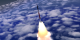 Rocket ascending into space passes by the camera.