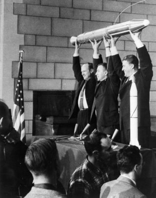 Left to right pictured Pickering, James Van Allen, Werner Von Braun holding up a model of Explorer 1 after its successful launch in 1958. Credit: NASA