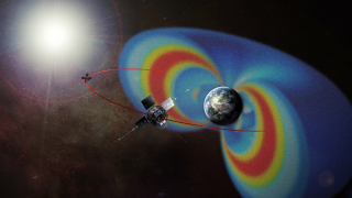 Still of the RBSP spacecraft orbiting Earth and showing their path through the two radiation belts, which are made visible in false color. Credit: NASA/Johns Hopkins University Applied Physics Laboratory