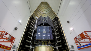 The stacked RBSP spacecraft just prior to encapsulation at Astrotech Space Operations in Florida, along with the RBSP team. Credit: NASA/ULA/KSC