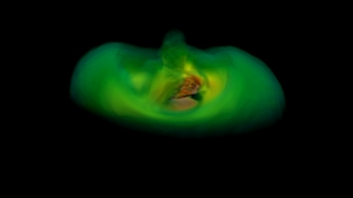 Frame from a simulation of a black hole merger employing both magnetic fields and the effects of the ionized gas in the accretion disk (redder colors correspond to greater density). This view is one orbit into the simulation, and already the first hint of what will develop into vertical funnel-like structure has emerged. Credit: NASA's Goddard Space Flight Center/P. Cowperthwaite, Univ. of Maryland