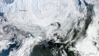 An unusually strong cyclone over the Arctic Ocean, seen here on Aug. 7, dispersed and cracked sea ice with fierce winds.