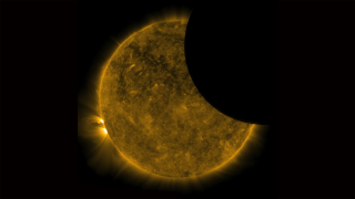 Earth's silhouette lacks perfectly sharp edges because a portion of the light passing through its atmosphere can be seen by SDO.