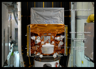 This image, taken in May 2008 as the Fermi Gamma-ray Space Telescope was being readied for launch, highlights the detectors of the spacecraft's Gamma-ray Burst Monitor (GBM). The GBM is an array of 14 crystal detectors designed for transient lower-energy gamma-ray outbursts, such as TGFs.  Labeled. Credit: NASA/Jim Grossmann