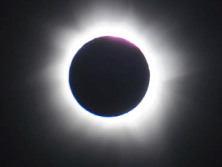 A total solar eclipse was visible from the Northern tip of Australia on Nov. 13, 2012 at 3:35 EST. The light halo visible around the edges of the moon is the sun's atmosphere, the corona. Credit: CNES/CNRS/NASA