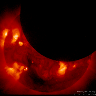 The JAXA/NASA Hinode mission witnessed two solar eclipses on Nov. 13, 2012, near in time to when a solar eclipse was visible in the southern hemisphere.  This movie shows the first, a total eclipse. Credit: JAXA/NASA/SAO