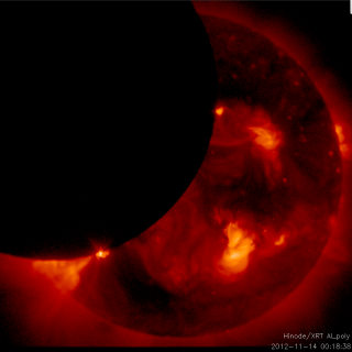 The second of two solar eclipses witnessed on Nov. 13, 2012 by Hinode, in which the moon skims the left limb of the sun for a partial eclipse. Credit: JAXA/NASA/SAO