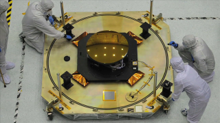 Video of James Webb Space Telescope's Secondary Mirror, along with a Primary Mirror segment arrives at the NASA Goddard Space Flight Center, Nov. 5, 2012.