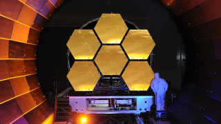 Preparing for the frigid void of space, six of the 18 primary mirror segments undergo cryogenic testing at NASA's Marshall Space Flight Center.