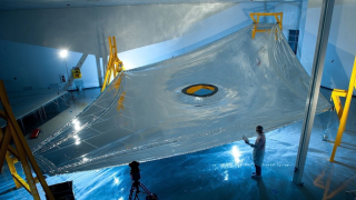 The giant sun shield will keep the telescope at the proper temperature to make observations.