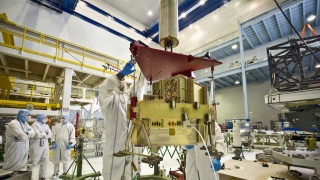 Webb's Fine Guidance Sensor (FGS), which will allow precision pointing to obtain high-quality images, is lifted for inspection.