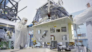 The Mid-Infrared Instrument (MIRI), which will detect light at wavelengths longer than any other Webb instrument, gets a lift in a NASA clean room.