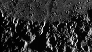 In this close-up view of the surface, Mercury's jagged topography meets the smooth terrain of a lava flow.