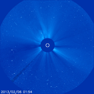The first of two CMEs from the evening of Feb. 5, 2013, can be seen bursting away from the sun in the upper left hand side of this image, which was captured by the joint ESA/NASA mission the Solar Heliospheric Observatory (SOHO) at 8:54 p.m. EST.  The sun itself is obscured in this picture &mdash taken by an instrument called a coronagraph — so that its bright light doesn't drown out the picture of the dimmer surrounding atmosphere, called the corona.