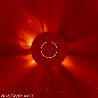The second of two CMEs from the evening of Feb. 5, 2013, can be seen bursting away from the sun in the upper left hand side of this image, which was captured by the joint ESA/NASA mission the Solar Heliospheric Observatory (SOHO) at 11:24 p.m. EST.  The sun itself is obscured in this picture &mdash taken by an instrument called a coronagraph — so that its bright light doesn't drown out the picture of the dimmer surrounding atmosphere, called the corona.