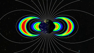 This visualization, created using actual data from the Relativistic Electron-Proton Telescopes (REPT) on NASA's Van Allen Probes, clearly shows the emergence of new third belt and second slot regions. The new belt is seen as the middle orange and red arc of the three seen on each side of the Earth. The twin Van Allen Probes launched on Aug. 30 2012. Credit: JHU/APL, from REPT data/LASP