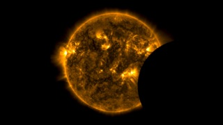 This video shows the sun in the 171 Ångström wavelength of extreme ultraviolet light.  It covers a time period of June 2, 2010 to April 15, 2013 at a cadence of two frames per day, or one frame every 12 hours.  Early in the sequence, SDO's coverage was intermittent, so not every day is represented.  171 Ångström light highlights material around 600,000 Kelvin and shows features in the upper transition region and quiet corona of the sun.  The still image shows a partial eclipse of the sun by the moon from SDO's perspective.