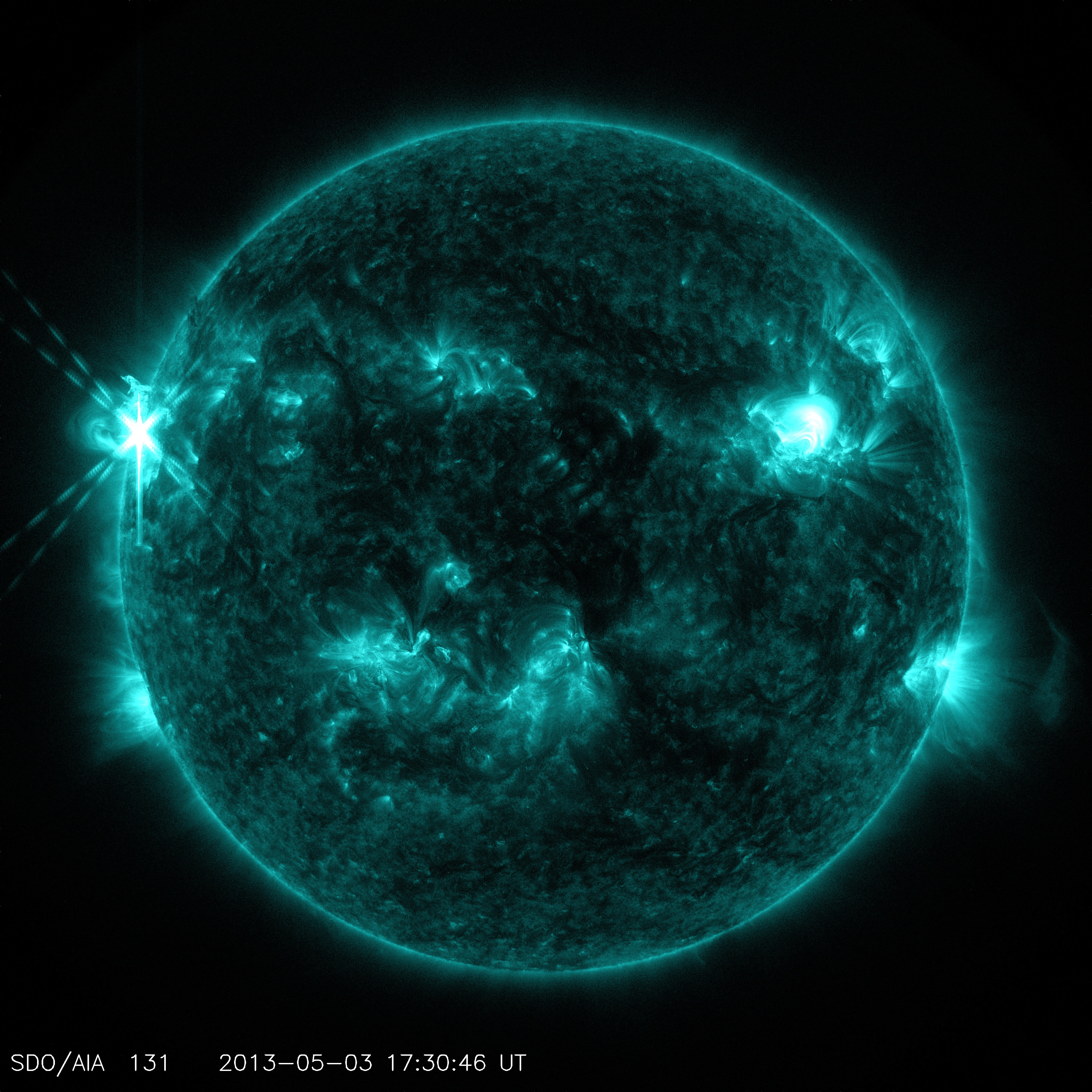 GMS: Sun Emits Mid-Level Flare and Prominence Eruption