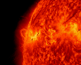 NASA's Solar Dynamics Observatory captured this image of sunspot group AR 1748, associated with all 4 X class solar flares on May 15, 2013. The image shows a blend of HMI continuum (similar to visible light) and AIA 304 ångström extreme ultraviolet. Credit: NASA/SDO
