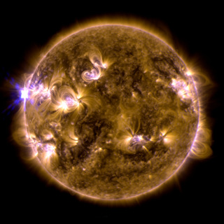 The sun erupted with an X1.7-class solar flare on May 12, 2013.  This is a blend of two images of the flare from NASA's Solar Dynamics Observatory (SDO) -- one image shows light in the 171 Ångström wavelength, the other in 131 Ångströms. Credit: NASA/SDO/AIA
