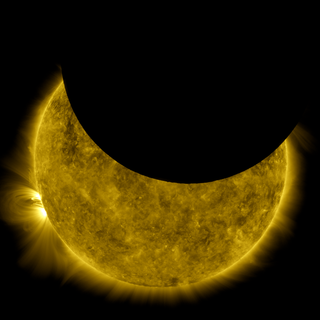 This image is a view of the sun captured by NASA's Solar Dynamics Observatory on Oct. 7, 2010, while partially obscured by the moon. A close look at the crisp horizon of the moon against the sun shows the outline of lunar mountains. Credit: NASA/SDO