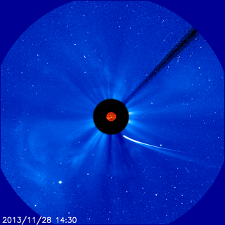 Comet ISON moves ever closer to the sun in this image from ESA and NASA's Solar and Heliospheric Observatory, or SOHO, captured at 9:30 a.m. EST on Nov. 28, 2013.  This image is a composite, with the sun imaged by NASA's Solar Dynamics Observatory, or SDO, in the center, and SOHO showing the solar atmosphere, the corona. Credit: ESA&NASA/SOHO/SDO