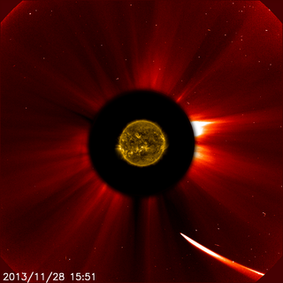 Comet ISON has moved quite close to the sun in this image from ESA/NASA's Solar and Heliospheric Observatory captured at 10:51 a.m. EST on Nov. 28, 2013. This image is a composite, with the sun imaged by NASA's Solar Dynamics Observatory in the center, and SOHO showing the solar atmosphere, the corona. Image Credit: ESA&NASA/SOHO/SDO