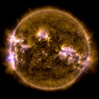An X-class solar flare erupted on the left side of the sun on the evening of Feb. 24, 2014.  This composite image, captured at 7:45 p.m. EST, shows the sun in ultraviolet light with wavelength of both 131 and 171 Ångströms. Credit: NASA/SDO