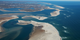 Islands and inlets grow and disappear within 30 years along the shores of Cape Cod.