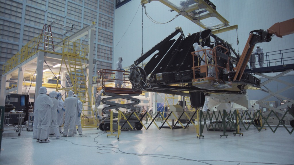 4K B-roll footage of the Webb Telescope Observatory being moved from the rollover fixture to the assembly stand inside the cleanroom.