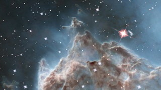 Link to Recent Story entitled: Evaporating Peaks: Pillars in the Monkey Head Nebula